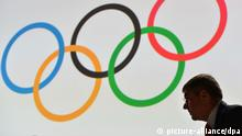 Germany's IOC Vice-President Thomas Bach takes place beneath a huge screen with the Olympic rings during the125th IOC Session at the Hilton hotel in Buenos Aires, Argentina, 09 September 2013. Photo: Arne Dedert/dpa