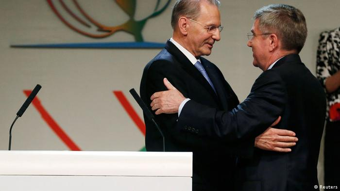 International Olympic Committee (IOC) President Jacques Rogge (L) embraces Thomas Bach of Germany after he was elected the ninth president of the IOC during a vote in Buenos Aires, September 10, 2013. REUTERS/Enrique Marcarian (ARGENTINA - Tags: SPORT OLYMPICS)