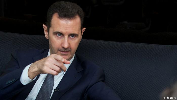 Syria's president Bashar al-Assad gestures during an interview with French daily Le Figaro in Damascus in this handout distributed by Syria's national news agency SANA on September 2, 2013. REUTERS/SANA/Handout (SYRIA - Tags: CONFLICT CIVIL UNREST POLITICS ) ATTENTION EDITORS - THIS IMAGE WAS PROVIDED BY A THIRD PARTY. FOR EDITORIAL USE ONLY. NOT FOR SALE FOR MARKETING OR ADVERTISING CAMPAIGNS. THIS PICTURE IS DISTRIBUTED EXACTLY AS RECEIVED BY REUTERS, AS A SERVICE TO CLIENTS
