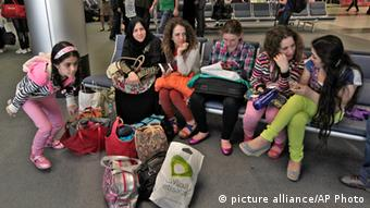 Syrian refugees wait before boarding a flight to Germany AP Photo/Bilal Hussein