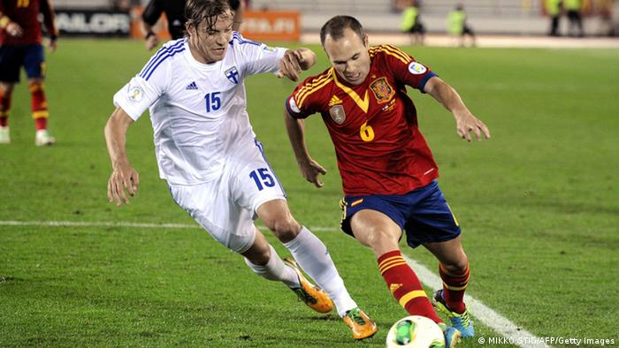 Finland's Markus Halsti and Spain's midfielder Andres Iniesta vie for the ball during the FIFA World Cup 2014 group I qualifying football match Finland vs Spain on September 6, 2013 in Helsinki, Finland. AFP PHOTO /Mikko Stig / LEHTIKUVA / FINLAND OUT (Photo credit should read MIKKO STIG/AFP/Getty Images)