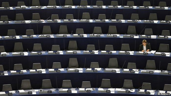 A single MEP is shown in a row of empty seats during a hearing
