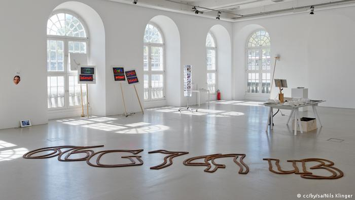 Inside museum, shot of giant iron captcha code sculpture on the floor Photo: cc/by/sa/Nils Klinger