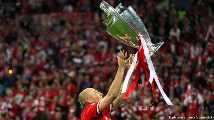 Arjen Robben holds the Champions League trophy aloft