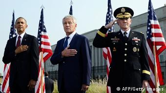 (L-R) US President Barack Obama, Defense Secretary Chuck Hagel and Joint Chiefs Chairman Gen. Martin Dempsey pay their respects at the Pentagon Memorial to mark the 12th anniversary of the 9/11 attacks on the South Lawn of the White House in Washington, DC, on September 11, 2013. AFP PHOTO/Jewel Samad AFP PHOTO / Jewel Samad (Photo credit should read JEWEL SAMAD/AFP/Getty Images)