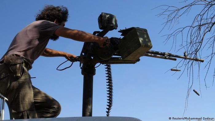 A Free Syrian Army fighter fires his weapon during what the FSA said were clashes with forces loyal to Syria's President Bashar al-Assad in Idlib, September 9, 2013. Picture taken September 9, 2013. REUTERS//Muhammad Qadour (SYRIA - Tags: POLITICS CIVIL UNREST CONFLICT)