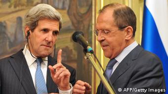 US Secretary of State John Kerry gestures as his Russian counterpart Sergei Lavrov tries to fix his translation equipment during a joint press conference following their meeting in Moscow on May 7, 2013. The United States and Russia today agreed to push both warring sides in the Syria conflict to find a negotiated solution and to hold an international conference in search of peace. AFP PHOTO / POOL / MLADEN ANTONOV (Photo credit should read MLADEN ANTONOV/AFP/Getty Images)