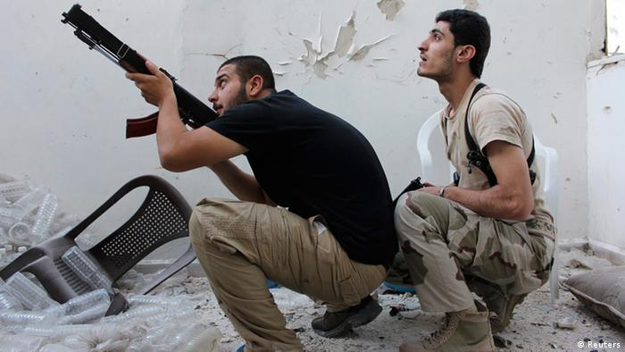 A Free Syrian Army fighter points his weapon as his fellow fighter watches in Aleppo's Al-Ezaa neighbourhood September 11, 2013. REUTERS/Aref Hretani (SYRIA - Tags: POLITICS CIVIL UNREST CONFLICT)