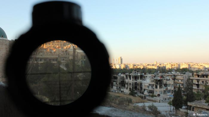 An area controlled by forces loyal to Syria's President Bashar al-Assad is seen through a sniper's scope held for the photographer by a Free Syrian Army fighter in Aleppo's Al-Ezaa neighbourhood September 11, 2013. REUTERS/Aref Hretani