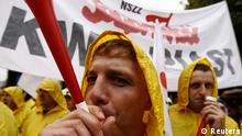 Protesters from the Solidarity Trade Union blow trumpets during an anti-government protest in front of the parliament building in Warsaw September 11, 2013. REUTERS/Kacper Pempel (POLAND - Tags: CIVIL UNREST POLITICS BUSINESS EMPLOYMENT)