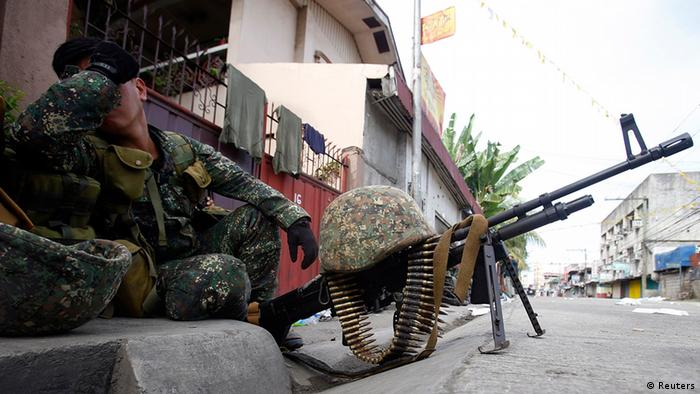 A member of Philippine Marines rests while guarding a road intersection on the fourth day of a government stand-off with the Moro National Liberation Front (MNLF) rebels in downtown Zamboanga city in southern Philippines, September 12, 2013. (Photo: Reuters)