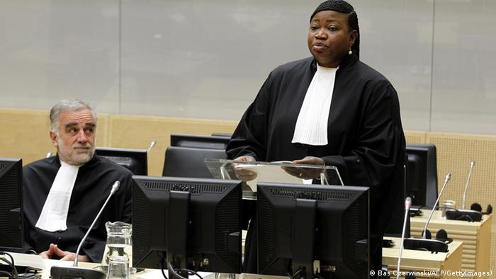 Former International Criminal Court's chief prosecutor Luis Moreno-Ocampo (L) listens as Fatou Bensouda (R) is holding her first speech as new prosecutor after her swearing-in ceremony as the International Criminal Court's new chief prosecutor in The Hague, on June 15, 2012. The 51-year-old Bensouda is the first woman and the first African to head the team of prosecutors at the tribunal, which is currently investigating 15 cases in seven countries, all of them African. Taking the oath before ICC judges and a public gallery packed with foreign diplomats and dignitaries, Bensouda vowed to continue to pursue those wanted for crimes of genocide, war crimes and crimes against humanity. AFP PHOTO/POOL/BAS CZERWINSKI netherlands out (Photo credit should read BAS CZERWINSKI/AFP/GettyImages)