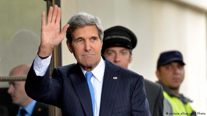 U.S. Secretary of State John Kerry waves as he arrives in Geneva, Switzerland, Thursday, Sept. 12, 2013, to test the seriousness of a Russian proposal to secure Syria's chemical weapons. Kerry and a team of U.S. experts will have at least two days of meetings with their Russian counterparts on Thursday and Friday. They hope to emerge with an outline of how some 1,000 tons of chemical weapons stocks and precursor materials as well as potential delivery systems can be safely inventoried and isolated under international control in an active war zone and then destroyed. (AP Photo/Keystone, Martial Trezzini)