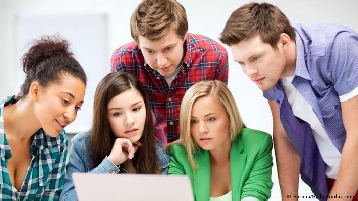 Young people in front of a laptop