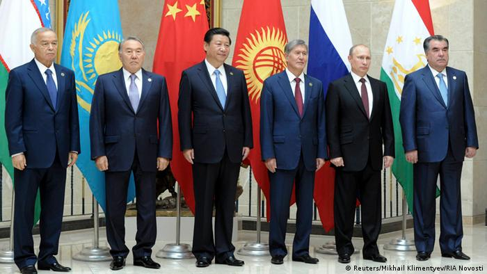 Tajikistan's President Emomali Rakhmon, Russia's President Vladimir Putin, Kyrgyzstan's President Almazbek Atambayev, China's President Xi Jinping, Kazakhstan's President Nursultan Nazarbayev and Uzbekistan's President Islam Karimov pose for a picture before a session of Shanghai Cooperation Organization (SCO) summit in Bishkek, September 13, 2013.
