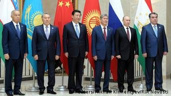 (R-L) Tajikistan's President Emomali Rakhmon, Russia's President Vladimir Putin, Kyrgyzstan's President Almazbek Atambayev, China's President Xi Jinping, Kazakhstan's President Nursultan Nazarbayev and Uzbekistan's President Islam Karimov pose for a picture before a session of Shanghai Cooperation Organization (SCO) summit in Bishkek, September 13, 2013. REUTERS/Mikhail Klimentyev/RIA Novosti/Kremlin (KYRGYZSTAN - Tags: POLITICS BUSINESS) ATTENTION EDITORS - THIS IMAGE HAS BEEN SUPPLIED BY A THIRD PARTY. IT IS DISTRIBUTED, EXACTLY AS RECEIVED BY REUTERS, AS A SERVICE TO CLIENTS