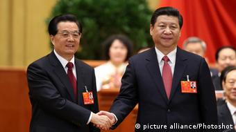 Hu Jintao (L) congratulates Xi Jinping at the fourth plenary meeting of the first session of the 12th National People's Congress (NPC) in Beijing, capital of China, March 14, 2013. Xi was elected president of the People's Republic of China (PRC) and chairman of the Central Military Commission of the PRC at the NPC session here on Thursday. (/Pang Xinglei) (hdt)