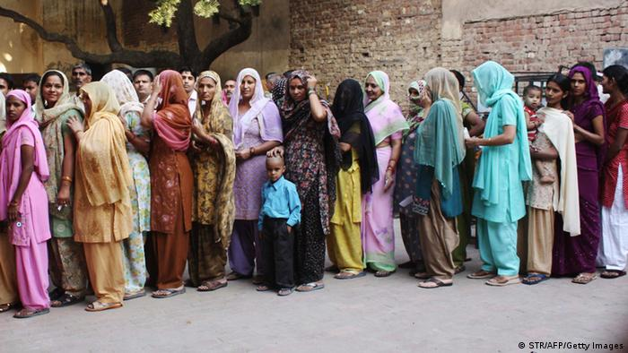 Indian voters queue to cast their votes