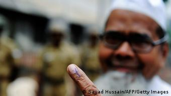 An Indian Muslim voter shows his ink-stained finger at a polling station in Mumbai on October 13, 2009. (Photo: Getty Images)