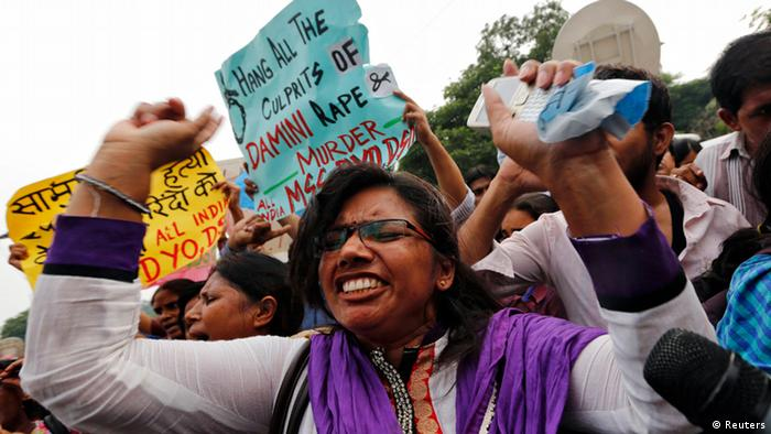 A demonstrator shouts slogans outside a court in New Delhi September 13, 2013. (Photo: Reuters)