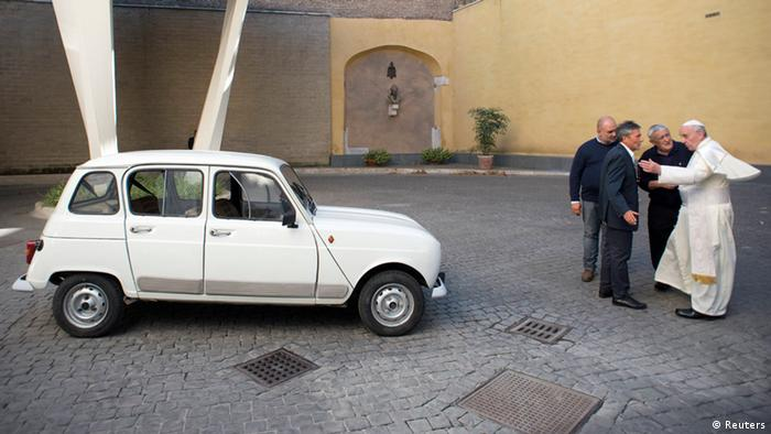 Renault 4 pope car with Pope Francis speaking with three men (Reuters)