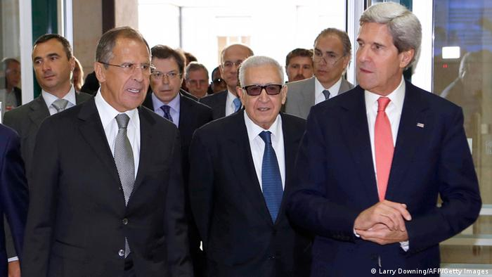 Russian Foreign minister Sergey Lavrov, United Nations-Arab League special envoy for Syria Lakhdar Brahimi and US Secretary of State John Kerry arrive at the UN headquarters in Geneva on September 13, 2013, to resume high-stakes talks on Syria's chemical weapons. Russia and the US were on September 13 set to huddle for a second day of key talks on how to secure Syria's chemical weapons amid reports Damascus was scattering the stockpile to frustrate efforts to track the deadly arsenal. AFP PHOTO / POOL / Larry Downing (Photo credit should read LARRY DOWNING/AFP/Getty Images)