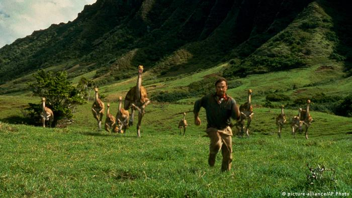 Film still from Jurassic Park with Alan Grant (Sam Neill) running from a herd of dinosaurs. (Photo: AP Photo/Universal Pictures, File)