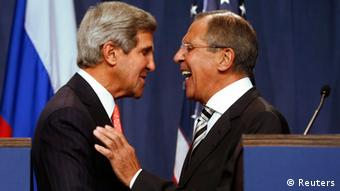 U.S. Secretary of State John Kerry (L) and Russian Foreign Minister Sergei Lavrov (R) shake hands after making statements following meetings regarding Syria, at a news conference in Geneva September 14, 2013. The United States and Russia have agreed on a proposal to eliminate Syria's chemical weapons arsenal, Kerry said on Saturday after nearly three days of talks with Lavrov. REUTERS/Larry Downing (SWITZERLAND - Tags: POLITICS CIVIL UNREST TPX IMAGES OF THE DAY)