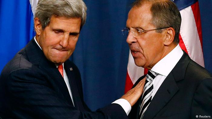 U.S. Secretary of State John Kerry (L) and Russian Foreign Minister Sergei Lavrov shake hands after making statements following meetings regarding Syria, at a news conference in Geneva September 14, 2013. The United States and Russia have agreed on a proposal to eliminate Syria's chemical weapons arsenal, Kerry said on Saturday after nearly three days of talks with Lavrov. REUTERS/Ruben Sprich (SWITZERLAND - Tags: POLITICS)