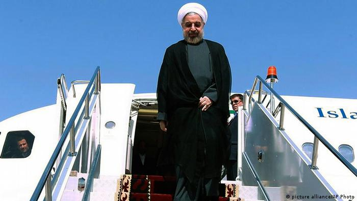 In this photo released by the official website of the office of the Iranian Presidency, Iran's President Hasan Rouhani steps out of his plane upon arrival to attend the Shanghai Cooperation Organization at Bishkek, Kyrgyzstan, Thursday, Sept. 12, 2013. The U.N. has slotted the new moderate-leaning president to address the global gathering of leaders on Sept. 24 - just hours after U.S. President Barack Obama is scheduled to wrap up his speech. (AP Photo/Presidency Office, Mohsen Rafinejad)