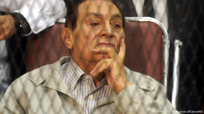 Former president Hosni Mubarak listens during the trial on Saturday, September 14, 2013 in Cairo, Egypt. Egyptian court adjourned to October 19 the retrial of former president Hosni Mubarak, his two sons, his interior minister, six security officials and a businessman in charges of killing peaceful demonstrators during the 2011 uprising and squandering public funds. Stringer - Anadolu Agency