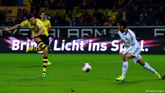 Robert Lewandowski of Dortmund scores
