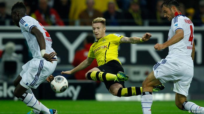 Borussia Dortmund's Marco Reus kicks a ball during the German first division Bundesliga soccer match against Hamburg SV in Dortmund September 14, 2013. REUTERS/Ina Fassbender (GERMANY - Tags: SPORT SOCCER) DFL RULES TO LIMIT THE ONLINE USAGE DURING MATCH TIME TO 15 PICTURES PER GAME. IMAGE SEQUENCES TO SIMULATE VIDEO IS NOT ALLOWED AT ANY TIME. FOR FURTHER QUERIES PLEASE CONTACT DFL DIRECTLY AT + 49 69 650050