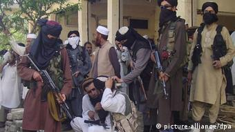 A picture dated 24 April 2009 shows armed Pakistani Talibans leaving Buner district adjacent to Swat valley Pakistan where Pakistani forces have been engaged in an operation against the Taliban. (Photo: EPA/RASHID IQBAL)