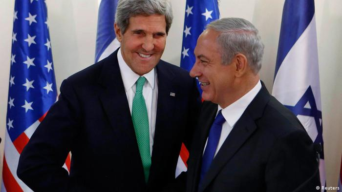 U.S. Secretary of State John Kerry (L) shakes hands with Israel's Prime Minister Benjamin Netanyahu at the prime minister's office in Jerusalem September 15, 2013. Kerry briefed Netanyahu on Sunday on a U.S.-Russian deal to remove Syria's chemical weapons, an accord that drew a guarded response from the Israeli leader. REUTERS/Larry Downing (JERUSALEM - Tags: POLITICS CIVIL UNREST)