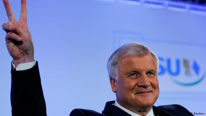 Bavarian State Premier and leader of the Christian Social Union (CSU) Horst Seehofer gestures as he addresses his party members in Munich, September 15, 2013. Angela Merkel's allies swept to victory in a state poll in Bavaria on Sunday, winning enough support to regain the absolute majority they had lost in 2008 and boosting the chancellor and her conservatives a week before a German federal election. The Christian Social Union (CSU), sister party of Merkel's Christian Democrats (CDU), won 49 percent according to a TV exit poll. Their coalition partner, the Free Democrats (FDP), polled just 3 percent, crashing out of the state assembly. REUTERS/Michael Dalder (GERMANY - Tags: POLITICS ELECTIONS)