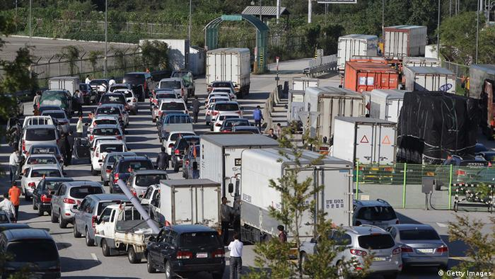 PAJU, SOUTH KOREA - SEPTEMBER 16: South Korean owners and workers' vehicles leave for North Korea's city Kaesong at the customs, immigration and quarantine office on September 16, 2013 in Paju, South Korea. North and South Korea have agreed to re-open the industrial park on a trial basis. North Korea withdrew over 50,000 of its staff from the factories owned by Seoul in April of this year, and South Korea removed managers in May, during the height of tensions between the two nations. (Photo by Chung Sung-Jun/Getty Images)