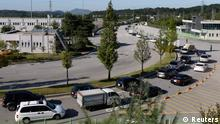 South Korean businessmen and workers in their vehicles leave the customs, immigration and quarantine office area, just south of the demilitarized zone separating the two Koreas in Paju, north of Seoul September 16, 2013, as they go to the inter-Korean Kaesong Industrial Complex in North Korea. North and South Korea have agreed to re-open the shuttered industrial park on a trial basis starting on Monday, the South's Unification Ministry said last Wednesday. The two Koreas will aim to attract foreign investors into the Kaesong industrial zone, a rare source of foreign currency for the North, the ministry said. REUTERS/Lee Jae-Won (SOUTH KOREA - Tags: BUSINESS POLITICS MILITARY)