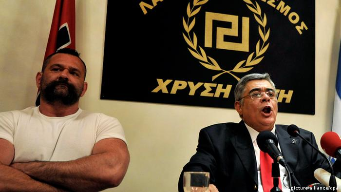 file - The head of the extreme rightwing Golden Dawn (Chryssi Avgi) party, Nikos Michaloliakos (R) speaks during a press conference in Athens, Greece, 06 May 2012. EPA/STR (zu dpa Euro-Krise und Flüchtlingsstrom beflügeln Rassismus vom 16.04.2013) +++(c) dpa - Bildfunk+++