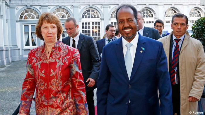 European Union foreign policy chief Catherine Ashton (L) and Somali's President Hassan Sheikh Mohamud (R) arrive at a conference called New Deal in Somalia in Brussels September 16, 2013. Somalia's government and international donors will sign up to a three-year plan on Monday to rebuild the violence-torn country, backed by pledges of new funding that EU officials hope could reach more than one billion euros. REUTERS/Yves Herman (BELGIUM - Tags: POLITICS BUSINESS)