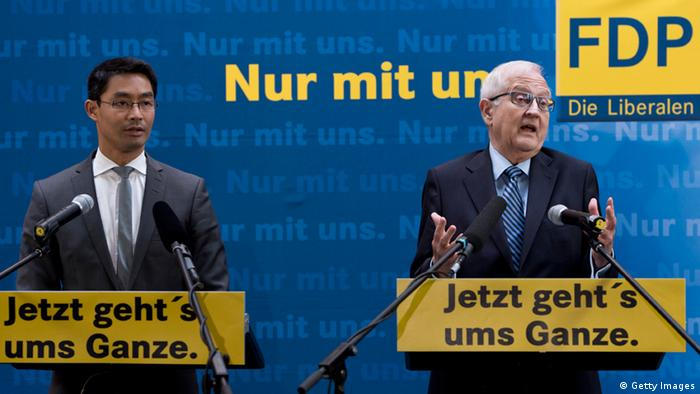German Economy Minister and Chairman of the liberal Free Democratic Party (FDP) Philipp Roesler (L) (photo: JOHN MACDOUGALL)