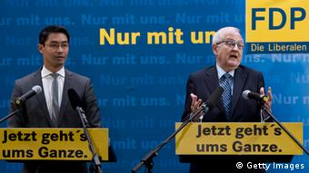 German Economy Minister and Chairman of the liberal Free Democratic Party (FDP) Philipp Roesler (L) and the FDP's main candidate in upcoming general elections Rainer Bruederle (C) attend a press conference in Berlin, Germany on September 16, 2013. The FDP performed poorly in the Bavarian regional elections, failing to secure any seats in the regional parliament. AFP PHOTO / JOHN MACDOUGALL (Photo credit should read JOHN MACDOUGALL/AFP/Getty Images)