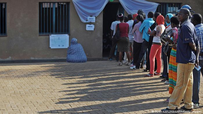 Rwandan voters queue outside at a polling station (Photo: TONY KARUMBA/AFP/Getty Images)