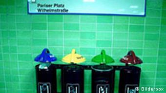 Four labeled trash cans in a Berlin subway station