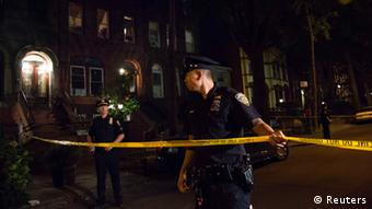 Policemen string police tape outside the Brooklyn residence Cathleen Alexis, mother of suspected Washington Navy Yard shooter Aaron Alexis, in New York September 16, 2013. A U.S. military veteran opened fire at the Washington Navy Yard on Monday in a burst of violence that killed 13 people, including the gunman, and set off waves of panic at the military installation just miles from the White House and U.S. Capitol. The FBI identified the suspect as Aaron Alexis, 34, of Fort Worth, Texas, a Navy contractor who had two gun-related brushes with the law. REUTERS/Andrew Kelly (UNITED STATES - Tags: CRIME LAW)