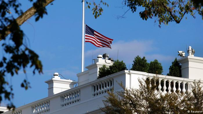 A U.S. flag flies at half staff at the White House September 16, 2013 in remembrance of victims of a shooting in the U.S. Navy Yard in Washington. A 34-year-old gunman opened fire at the Navy Yard in Washington in a shooting that left 13 people dead at the busy military installation not far from the U.S. Capitol and the White House. The suspect was identified by the FBI as Aaron Alexis of Fort Worth, Texas. Washington D.C. police chief Cathy Lanier told reporters that Alexis was engaged in shooting with police officers when he died. REUTERS/Yuri Gripas (UNITED STATES - Tags: POLITICS CRIME LAW)