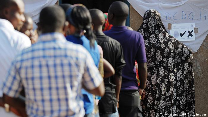 Rwandan voters queue outside a polling station in the capital Kigali (TONY KARUMBA/AFP/Getty Images)