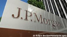 A JPMorgan sign is seen outside the office tower housing the financial services firm's Los Angeles, California offices, August 8, 2013. US banking giant JPMorgan Chase said August 8, 2013 it is facing parallel civil and criminal investigations over its sale of mortgage-backed securities before the financial crisis. JPMorgan disclosed in a securities filing that in May it was notified by the civil division of the US Attorneys Office for the Eastern District of California stating that it had preliminarily concluded that the bank 'violated certain federal securities laws' in connection with the subprime mortgage-backed securities. AFP PHOTO / Robyn Beck (Photo credit should read ROBYN BECK/AFP/Getty Images)