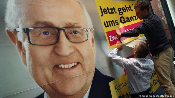 GettyImages 180689014 BERLIN, GERMANY - SEPTEMBER 16: Workers adhere posters that read: 'Now it's about the whole thing' onto an election campaign billboard that depicts lead candidiate of the German Free Democrats (FDP) Rainer Bruederle at FDP party headquarters on September 16, 2013 in Berlin, Germany. The FDP faired disastrously in Bavarian state elections held the previous day and failed to get enough votes to retain seats in the Bavarian parliament. Germany faces federal elections on September 22 and the FDP, which is the current German government coalition partner with the German Christian Democrats (CDU), is facing an uphill battle. (Photo by Sean Gallup/Getty Images)