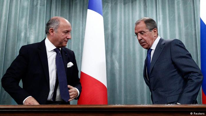Russia's Foreign Minister Sergei Lavrov (R) and his French counterpart Laurent Fabius attend a news conference in Moscow, September 17, 2013. Russia still suspects an August 21 poison gas attack in Syria was a provocation by rebel forces and says a report by U.N. inspectors does not answer all of its questions about the attack, Lavrov said on Tuesday. REUTERS/Maxim Shemetov (RUSSIA - Tags: POLITICS)
